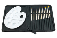 Paintbrush set with mixing palette on white background Stock Image