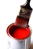 Paintbrush on tin. Photograph of a paintbrush on a tin of red gloss paint Stock Photography