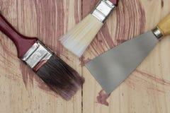Paintbrush tools on wooden background Stock Photo