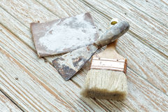 Paintbrush  trowel sandpaper still life wood teak antique. Paintbrush  trowel sandpaper still life wood teak table antique white old style Stock Photos