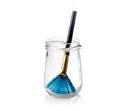 Paintbrush w szklanych butelkach odizolowywać na bielu Obrazy Stock