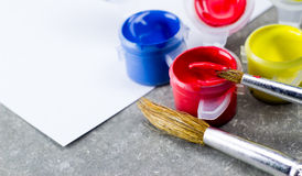 Paintbrush and watercolor Stock Images