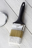 Paintbrush and white paint Royalty Free Stock Photos