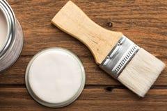 Paintbrush wood coating tool wood teak still life background Royalty Free Stock Photography