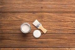 Paintbrush wood coating tool wood teak still life background Stock Image