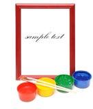 Paintbrush, wood frame and paint Stock Image