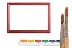 Paintbrush, wood frame and paint Stock Photo