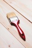 Paintbrush on wooden surface. Paintbrush lying on wooden surface Royalty Free Stock Photo