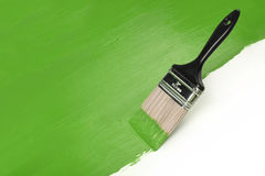 Paintbrush Z Greeen farbą Fotografia Stock