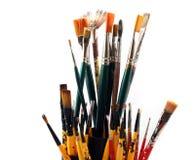 paintbrushes предпосылки близкие поднимают белизну Стоковое фото RF