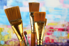 Paintbrushes. Old paintbrushes on painted background royalty free stock photography