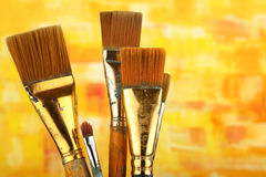 Paintbrushes. Old paintbrushes on painted background royalty free stock photos