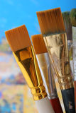 Paintbrushes. Old paintbrushes on painted background stock photos