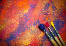 Paintbrushes on abstract background Royalty Free Stock Photography