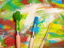 Paintbrushes on abstract background Royalty Free Stock Photos