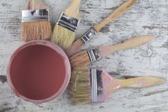 Free Paintbrushes And Paint Can In A Wood Background Stock Image - 47218941