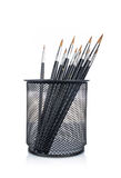 Paintbrushes in the basket Stock Images