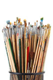 Paintbrushes in black holder cup Royalty Free Stock Images