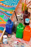 Paintbrushes and bottles with color pigments Stock Photography