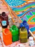 Paintbrushes and bottles with pigments. For cold batik stock images