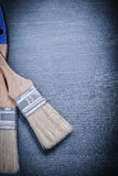 Paintbrushes with bristle on wooden board Royalty Free Stock Images