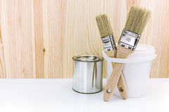 Paintbrushes with cans Stock Images