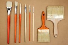 Paintbrushes on cardboard Royalty Free Stock Photo