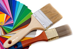 Paintbrushes and color samples. Over white background stock photos