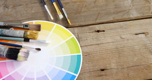Paintbrushes with color swatch stock video footage