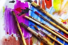 Paintbrushes on a colored paper royalty free stock images