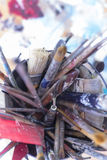Paintbrushes on a container - painting session Royalty Free Stock Photo