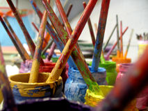 Paintbrushes Covered In Paint In Jars - Horizontal Stock Photos