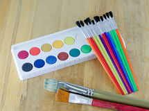 Paintbrushes. Desk of an artist with watercolor paints and paintbrushes Royalty Free Illustration