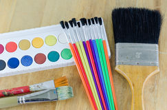 Paintbrushes. Desk of an artist with watercolor paints and paintbrushes Stock Photography