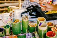 Paintbrushes in fresh bamboo vase Royalty Free Stock Images