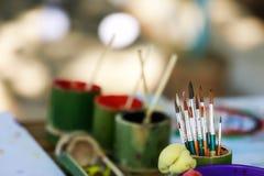 Paintbrushes in fresh bamboo vase Stock Photo