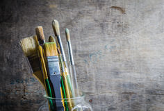 Paintbrushes in a glass jar Royalty Free Stock Photos