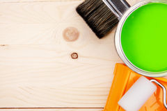 Paintbrushes and green paint bucket Stock Photos