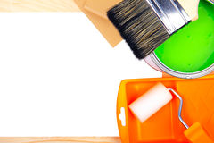 Paintbrushes and green paint bucket Stock Images