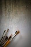 Paintbrushes on grunge vertical background Stock Image