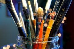 Paintbrushes in jar Stock Photography