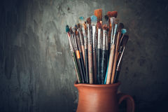 Paintbrushes in a jug. Stock Images