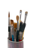 Paintbrushes in a metal mesh holder Stock Photos