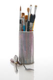 Paintbrushes in a metal mesh holder Royalty Free Stock Photos