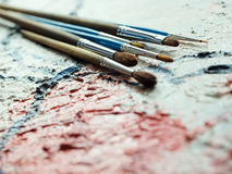 Paintbrushes on oil painting canvas Stock Image