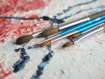 Paintbrushes on oil painting canvas Stock Photo