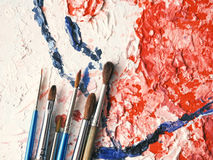 Paintbrushes on oil painting canvas Royalty Free Stock Photography