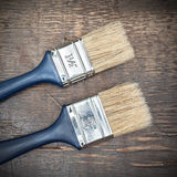 Paintbrushes on an old wooden table Stock Images