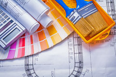 Paintbrushes paint can blueprints calculator color Stock Photography