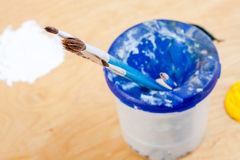 Paintbrushes with paint oil on palette. Stock Photography
